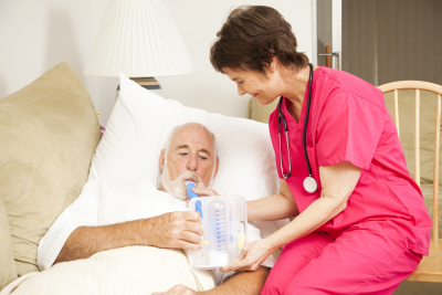 Home health nurse helps a senior patient